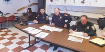 Shown (l to r) Sergeant Tom Lema, Captain Thomas Lee and Officer Ted Boyle at North End Public Safety monthly meeting.